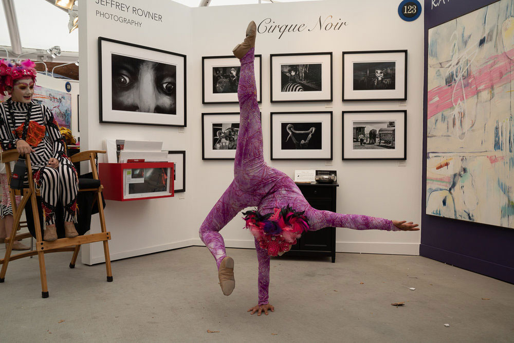 Family Art handstand at booth